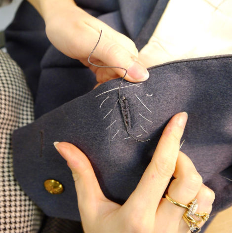 Jules Walker, Military Finisher at Gieves & Hawkes, demonstrates buttonhole techniques