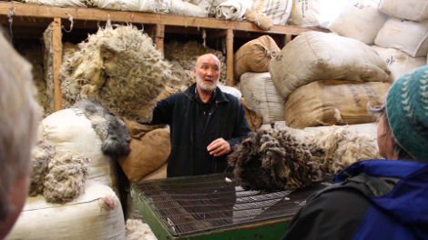 Oliver Henry doing a wool sorting demonstration, a very popular event at Shetland Wool Week