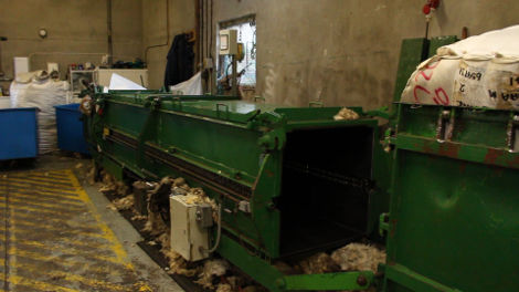 This machine is a wool press, it packs the sorted fleece tightly into bales for storage and transportation.